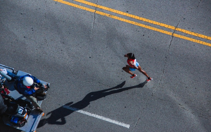 Black woman runner running on the street